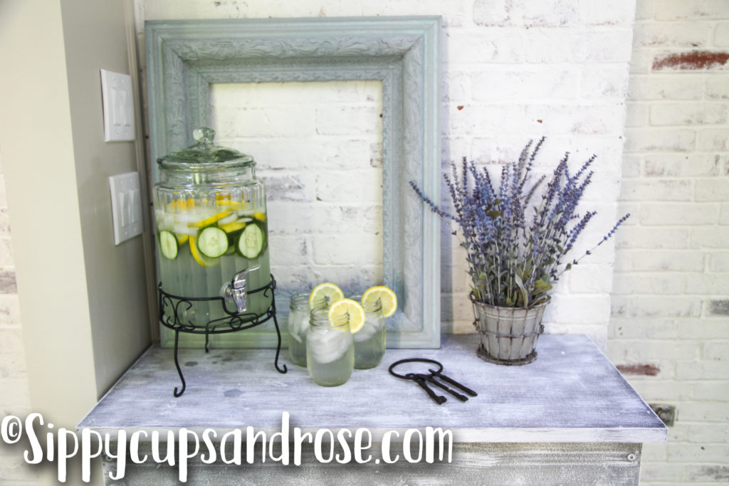 An Elegant White Washed Drinks Table by lifestyle blogger Anya of Sippy Cups and Rose
